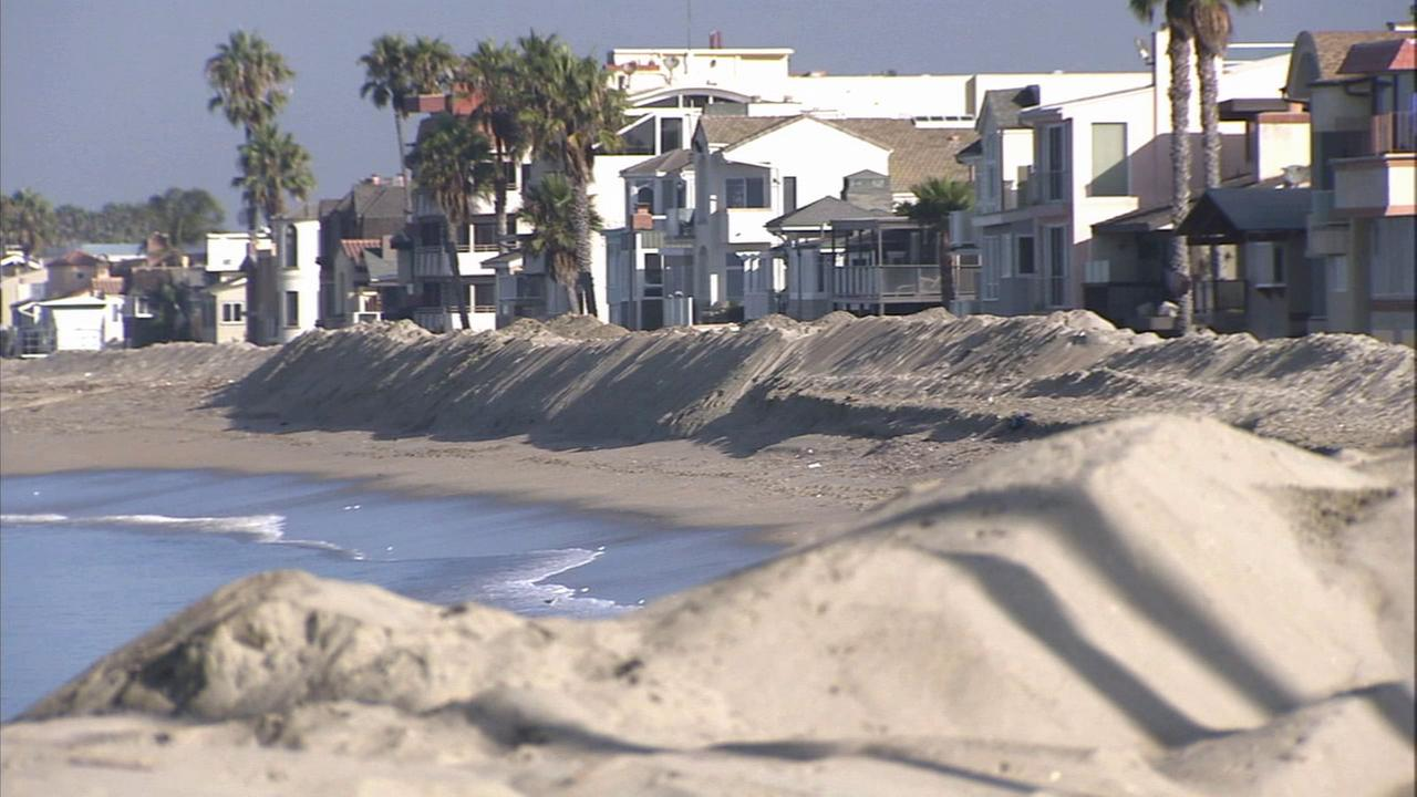 A sand berm is seen along a Southern California beach on Tuesday, Aug. 26, 2014.