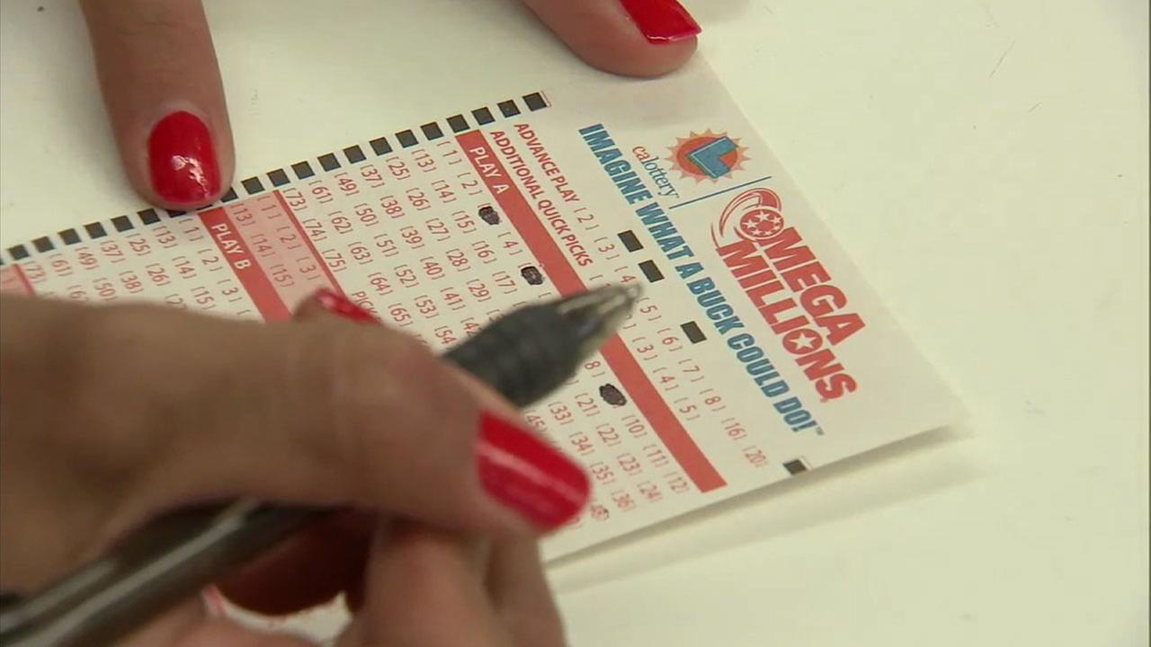 A woman filling out a Mega Millions ticket is shown in a file photo.