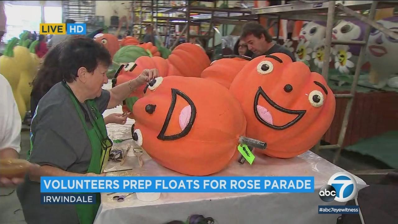 Volunteers are seen prepping floats in Irwindale for the 129th Tournament of Roses Parade.