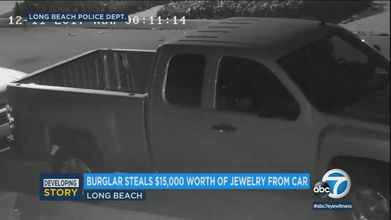 Surveillance video shows a thief  breaking into a car in Long Beach on Dec. 11, 2017.