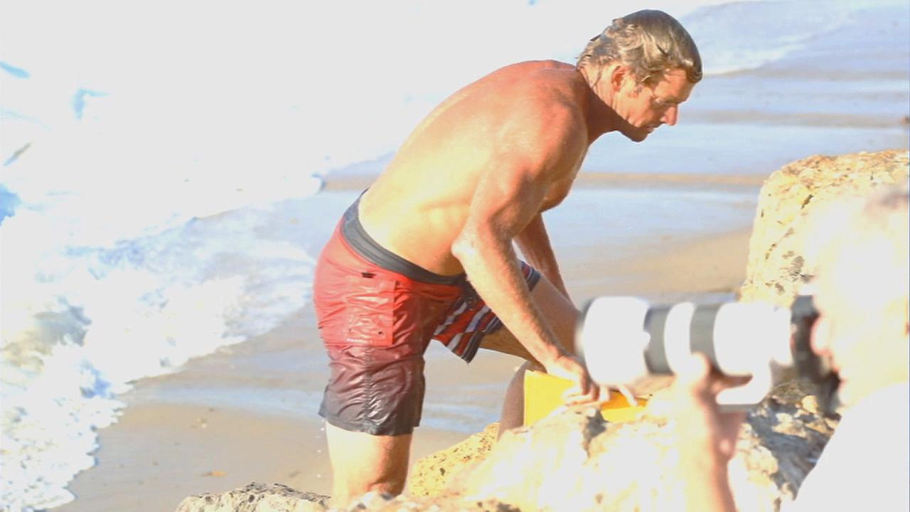 Surfing legend Laird Hamilton came to the rescue of a distressed surfer in Malibu Wednesday morning.