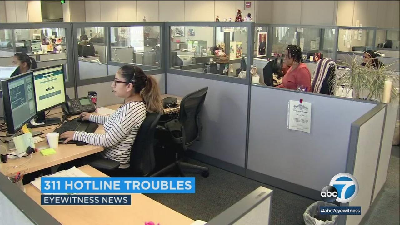People working for the 311 hotline for Los Angeles are shown at the office.