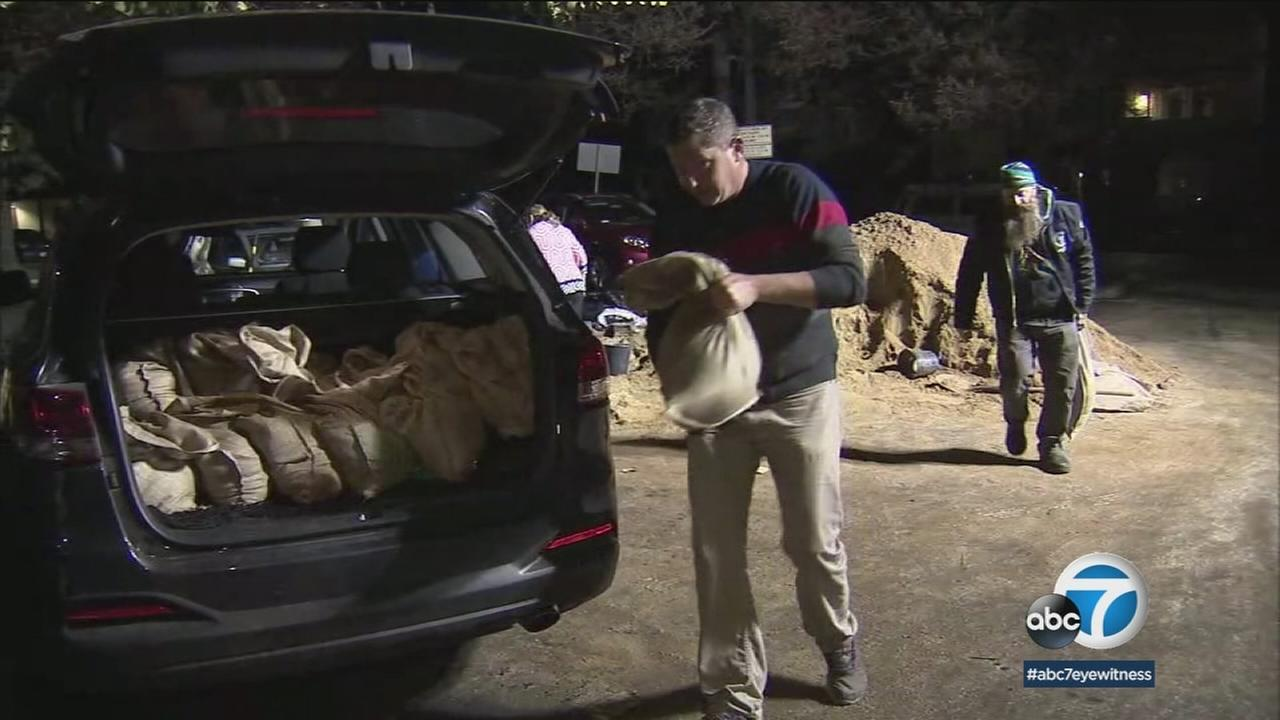 Ventura residents pack their cars with sandbags to prepare for rainfall expected Tuesday, Jan. 9, 2018.
