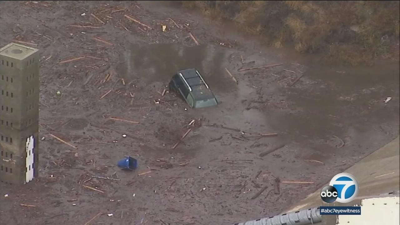 A car buried in mud is shown in Burbank after a mudslide erupted in an area burned by the La Tuna Canyon Fire.