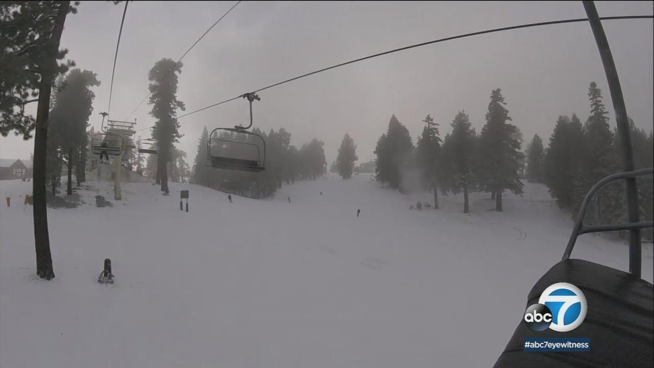Snowfall on a ski lift is shown in a GoPro photo.