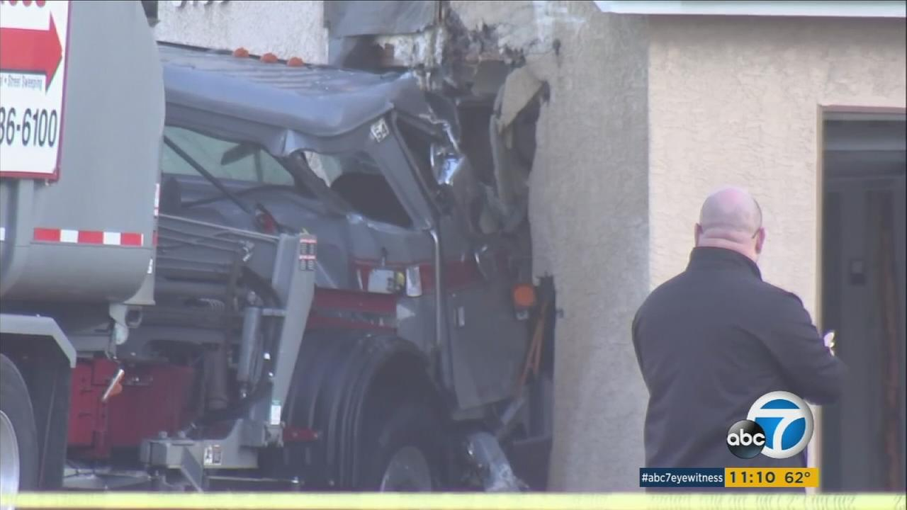 A Temple City couple escaped a terrifying crash when a garbage truck slammed into their townhouse Thursday morning.