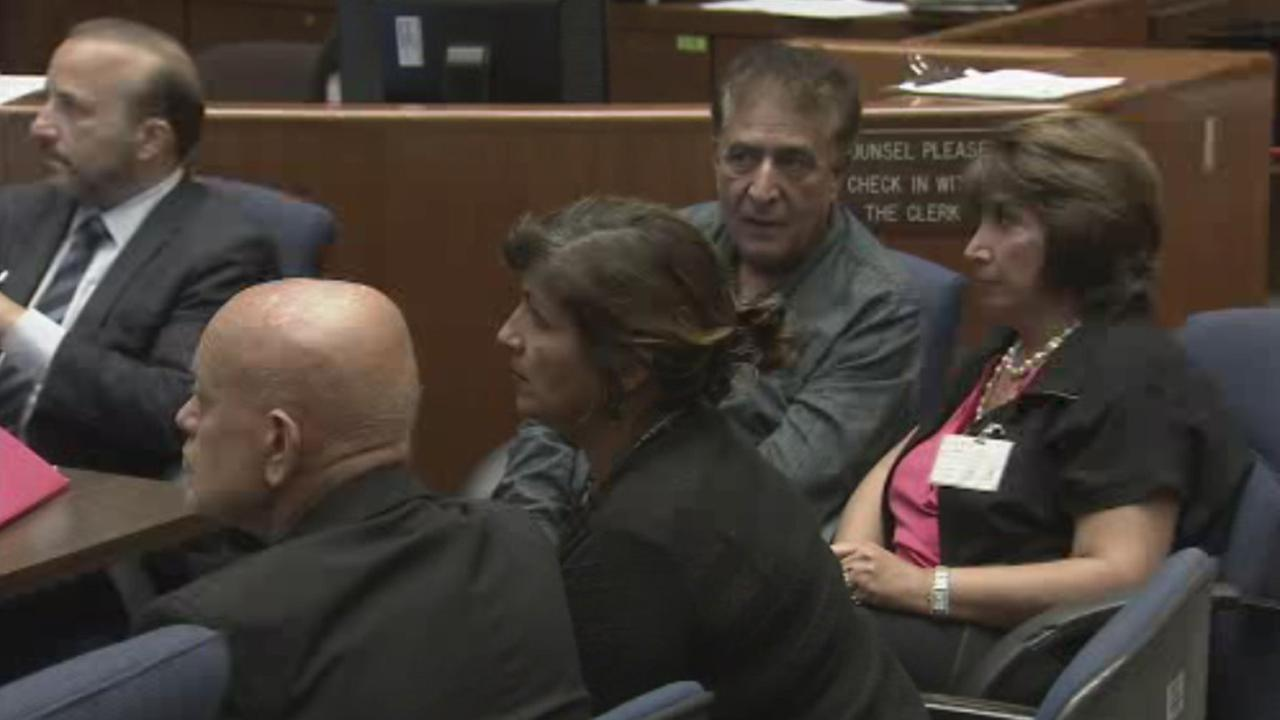 Dr. Yahya Hedvat, center, is seen in court on Wednesday, Sept. 03, 2014.