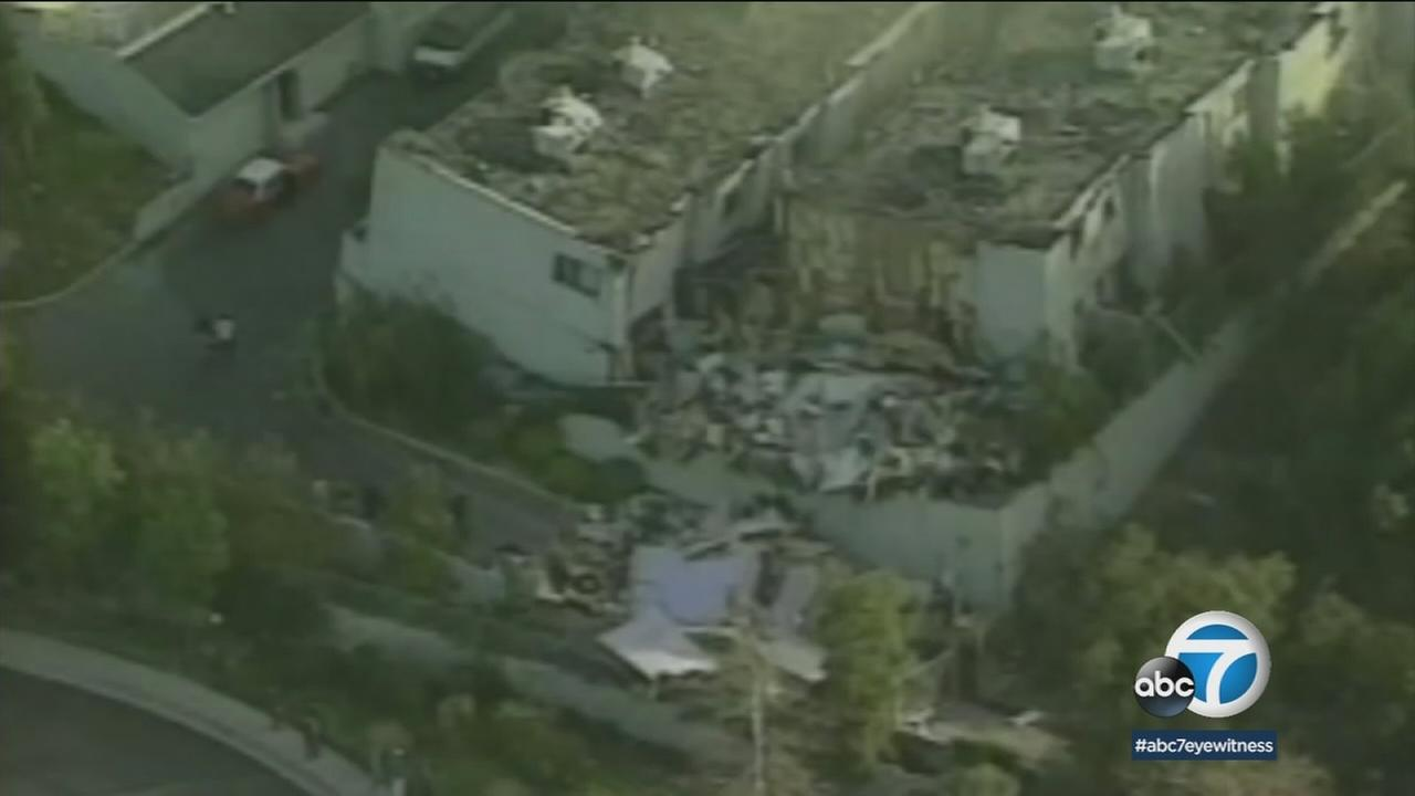 A flattened building is shown in archival footage of the 1994 Northridge earthquake that struck on Jan. 17.