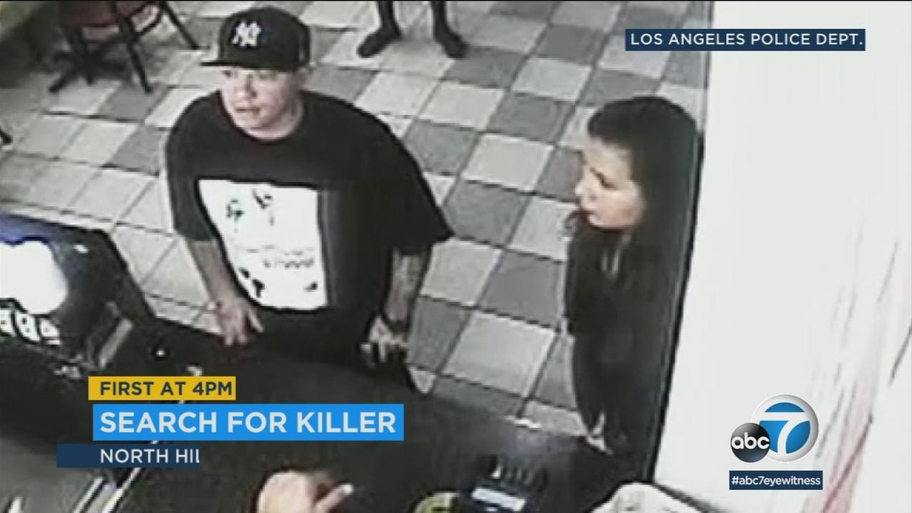A male suspect and a woman are shown at a KFC in North Hills in surveillance video. They are suspects in a murder.