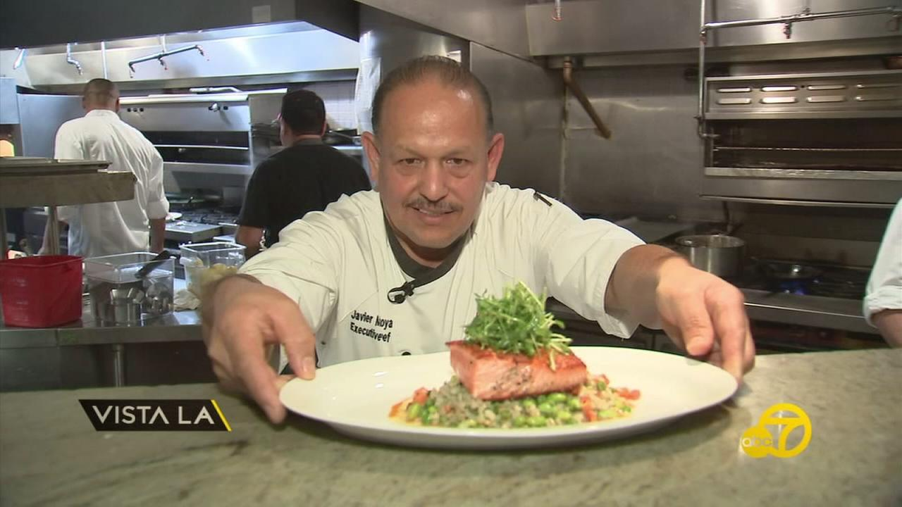 Chef Javier Montoya is shown serving up a dish at a restaurant.
