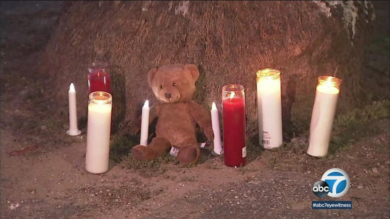 A memorial site is set up for a 3-year-old boy who was shot to death in Compton in a gang-related incident.