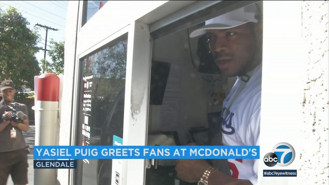 Dodgers outfielder Yasiel Puig worked the drive-thru in an appearance at a Glendale McDonalds.