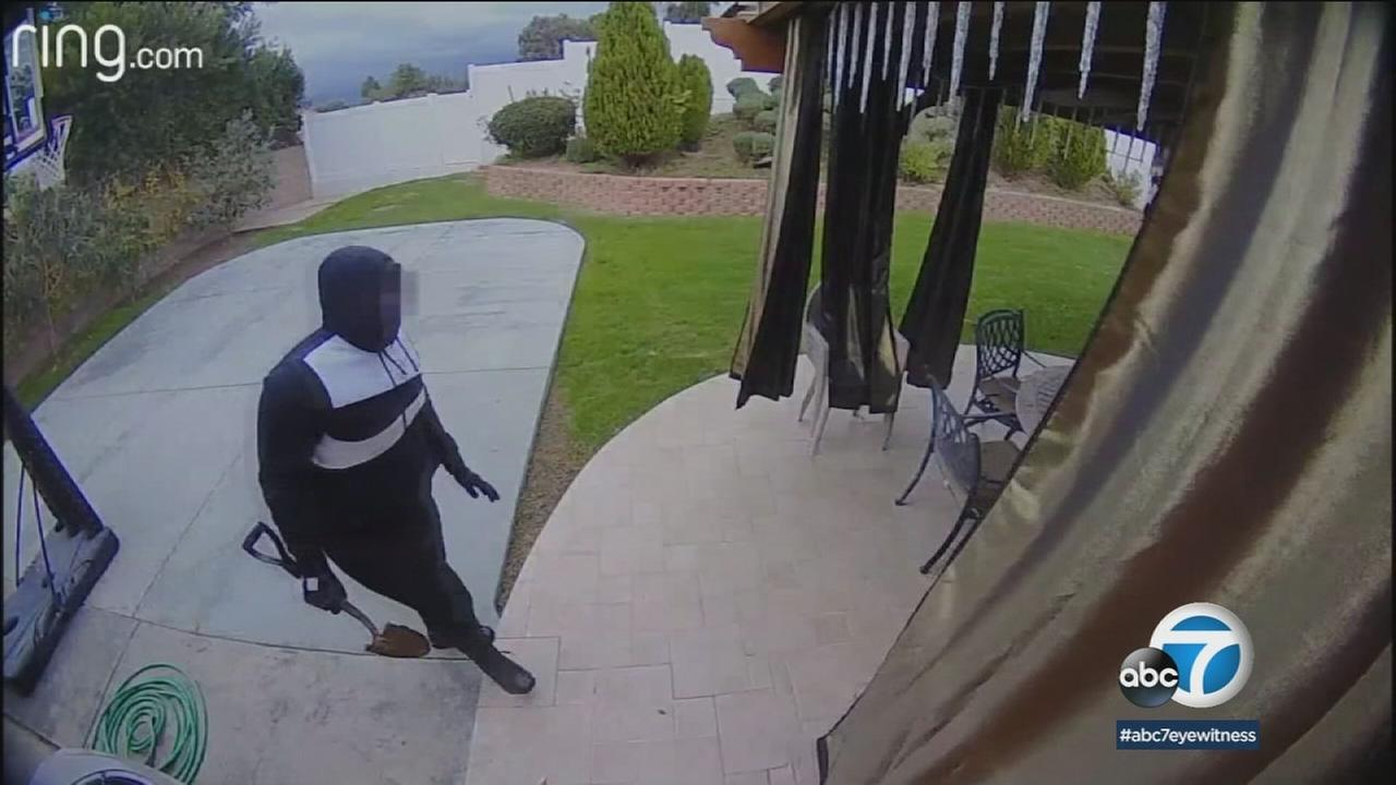 Two suspected burglars were captured on home surveillance video entering the yard of a Tarzana home while the owners were away.