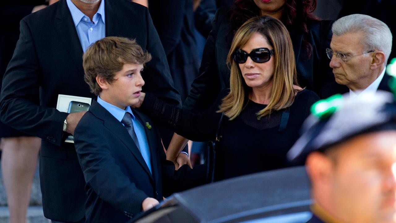 Melissa Rivers and her son Cooper Endicott walk to a waiting car after the funeral service for comedian Joan Rivers at Temple Emanu-El in New York Sunday, Sept. 7, 2014.
