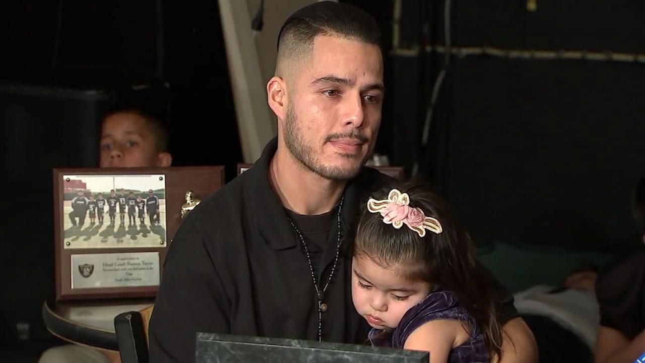Raymond Torres, 30, is shown in a photo with his daughter during a press conference about his possible deportation on Monday, Jan. 29, 2018.