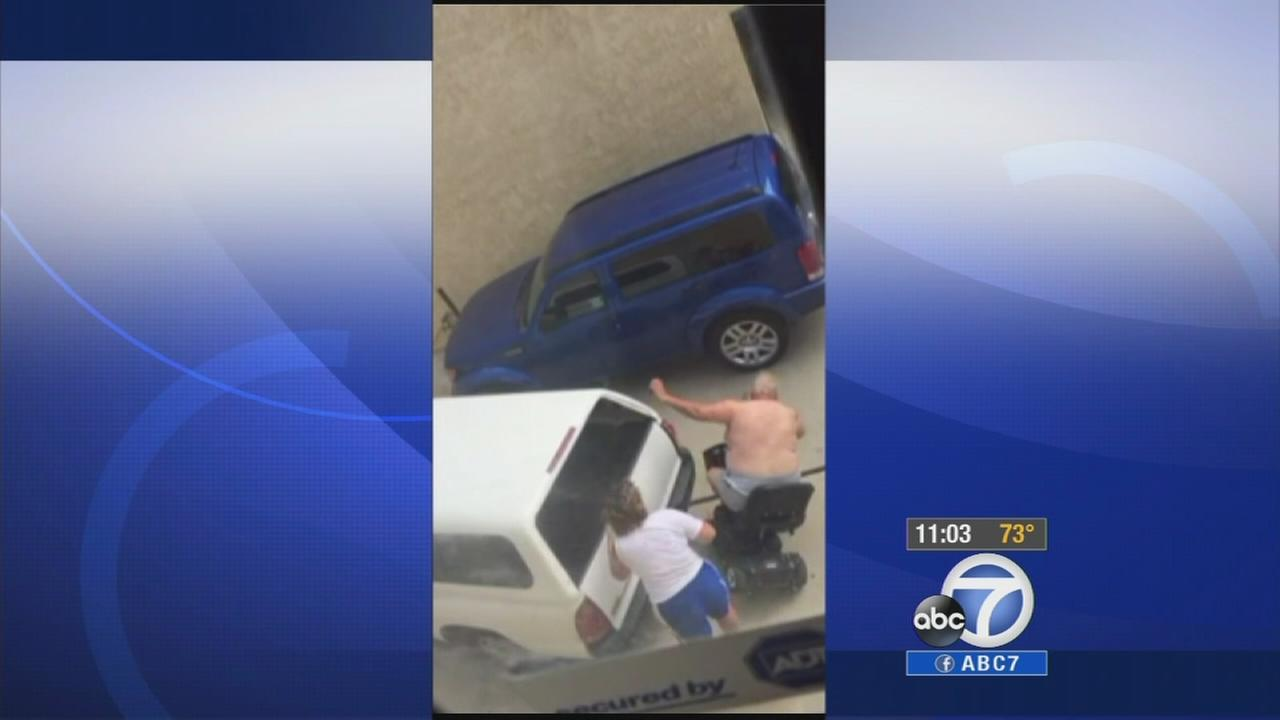 A woman knocks her common law husband off his scooter on Sunday, Sept. 7, 2014.