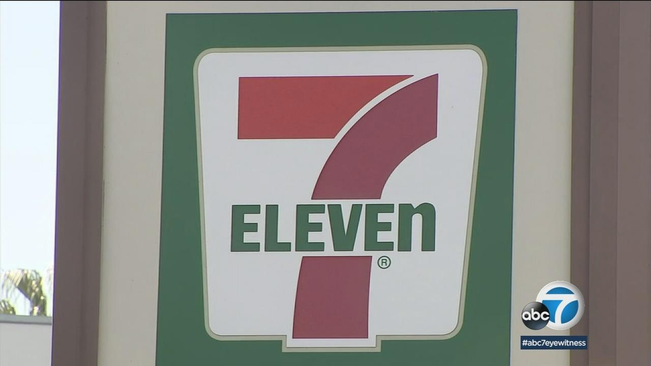 A 7-Eleven sign is shown in Culver City after a clerk was shot trying to retrieve stolen beer from a thief.