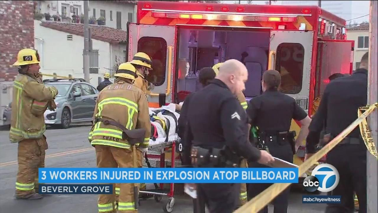 A person is placed in an ambulance following an explosion atop a billboard platform in Beverly Grove on Tuesday, Feb. 6, 2018.