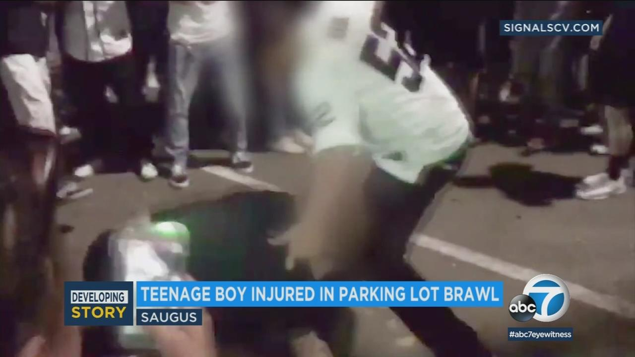 Two teens were captured on video throwing punches in a parking lot in Saugus.