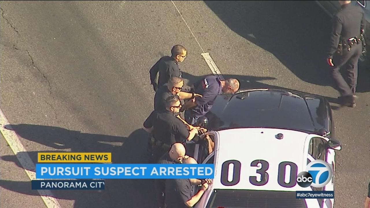 A man was arrested after he allegedly fired gunshots at his workplace, then led police on a short chase through the San Fernando Valley.
