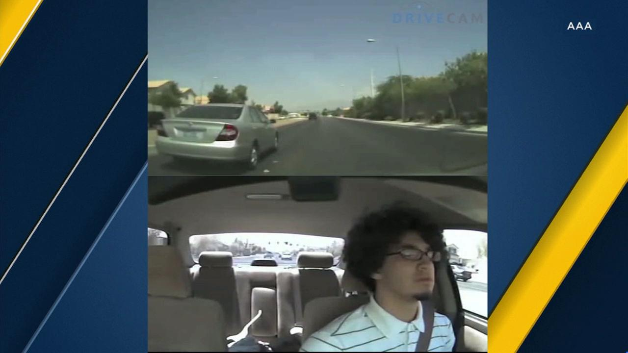 A person is seen driving while feeling drowsy.