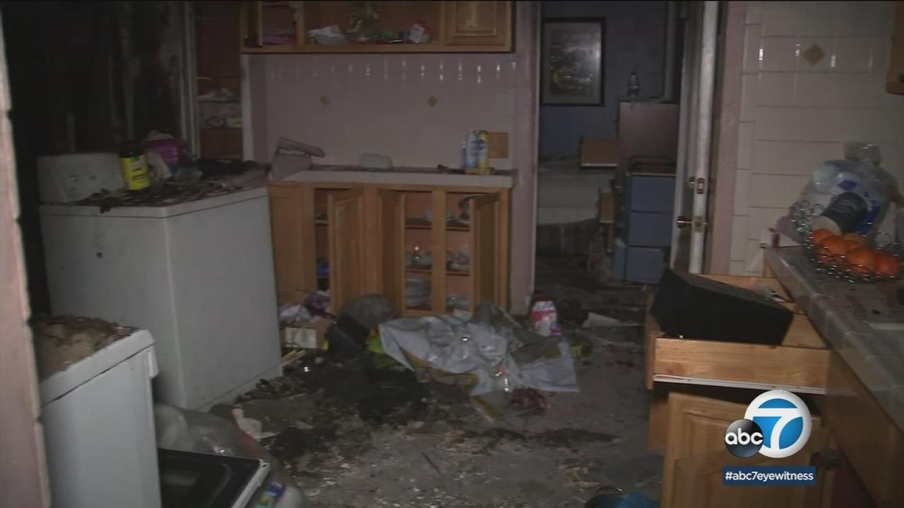 A charred and mangled apartment in El Sereno that was burglarized hours after being ripped apart by a fire is shown.