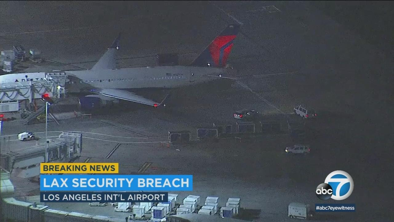 One person was taken into custody after a security breach at Los Angeles International Airport Saturday night, officials said.