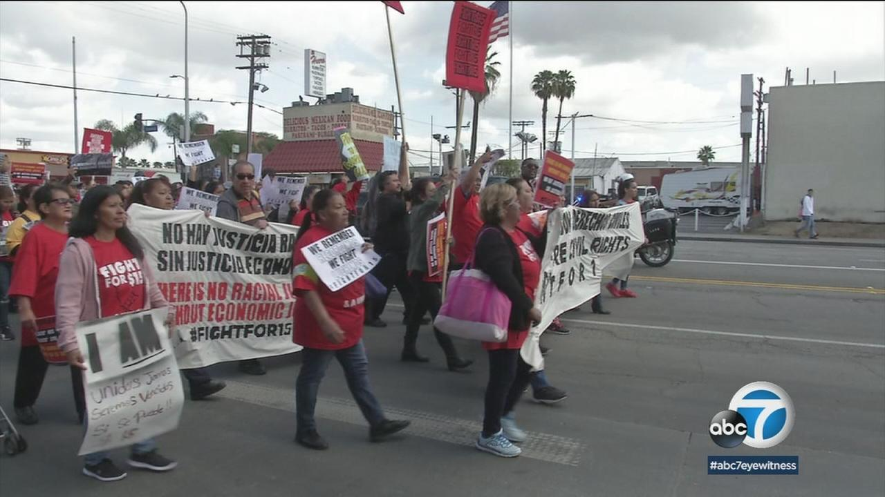 Fifty years after the historic Memphis sanitation workers strike, fast-food employees marched in Los Angeles on Monday to demand unionization and a $15 minimum wage.