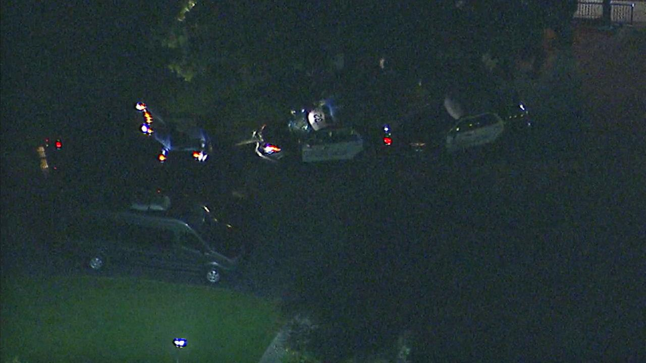 Authorities surrounded a suspect who barricaded himself inside a squad car in Garden Grove on Tuesday, Feb. 13, 2018.