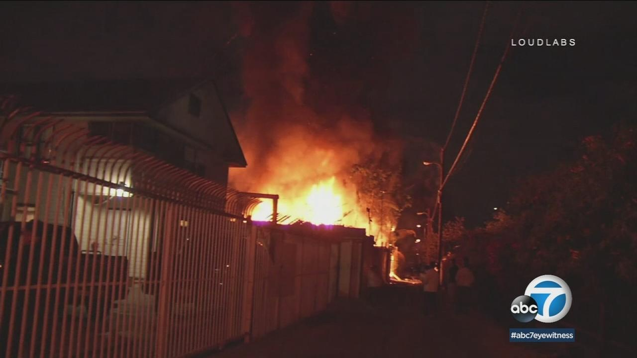 Fifty people were displaced by a massive fire that engulfed a single-family home in the Florence-Firestone neighborhood of South Los Angeles late Tuesday evening, officials said.