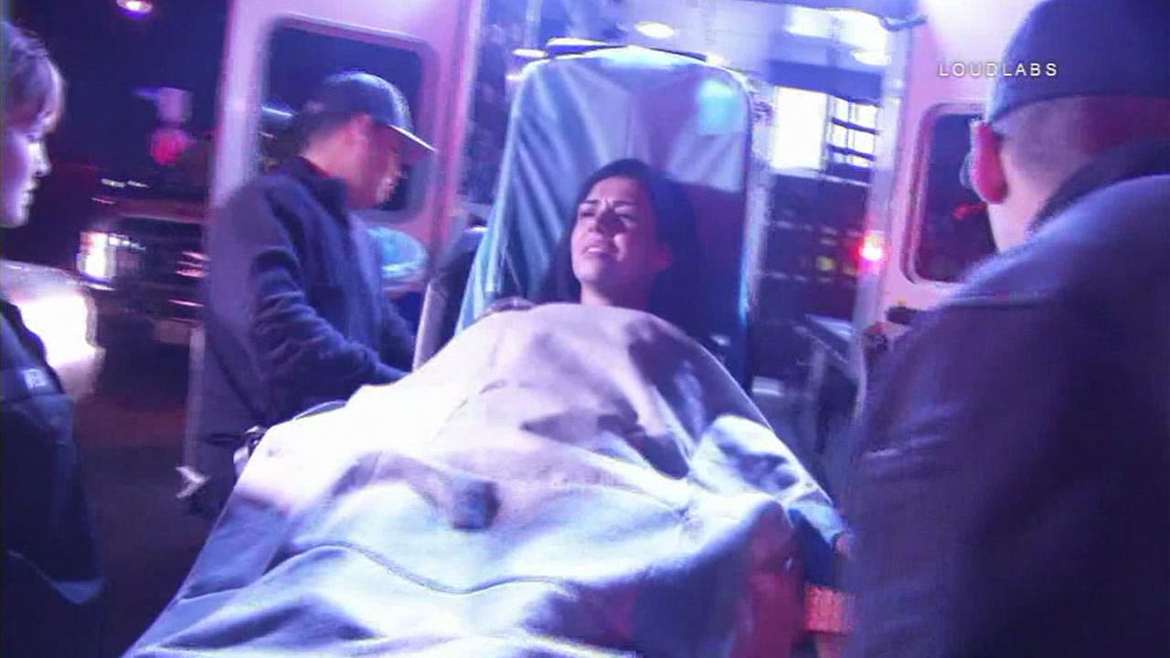 A suspected DUI driver is shown being placed into an ambulance after she fought officers to avoid being arrested at the end of a high-speed chase in L.A.