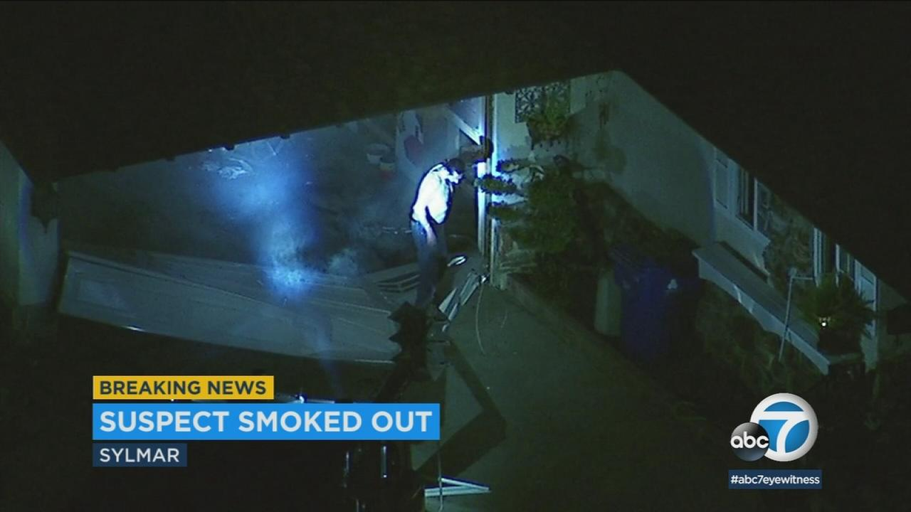 A man was taken into custody after an hours-long barricade in Sylmar that ended with tear gas and partial destruction of the home where he was hiding.