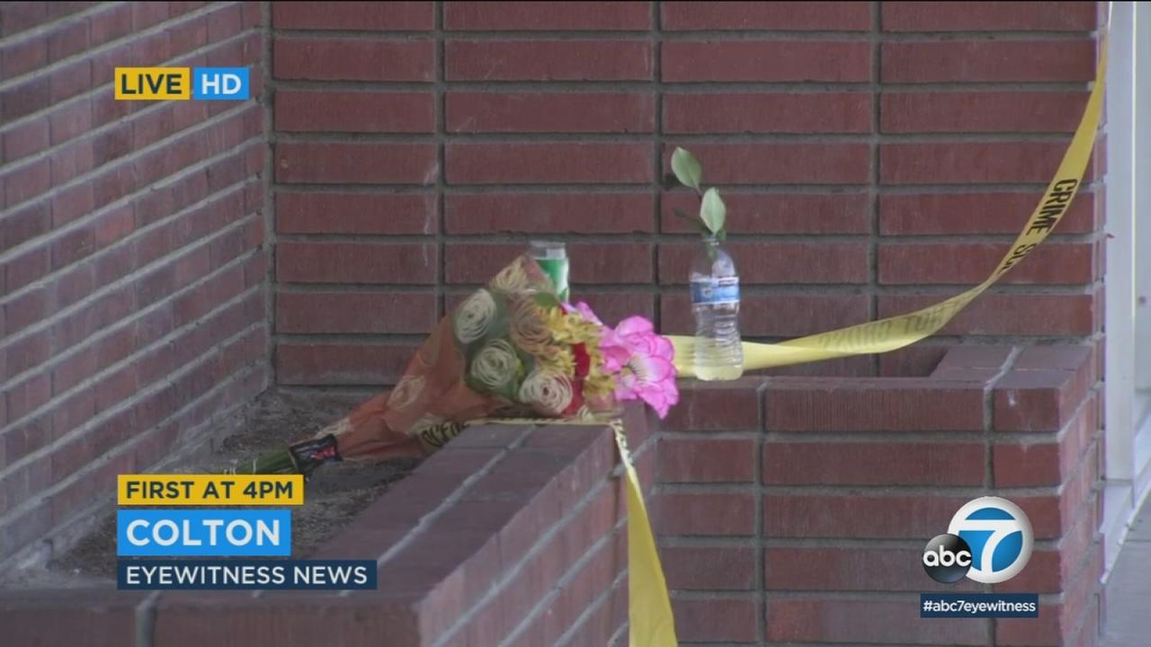 An impromptu memorial was established outside a Colton bar where a woman was shot and killed.