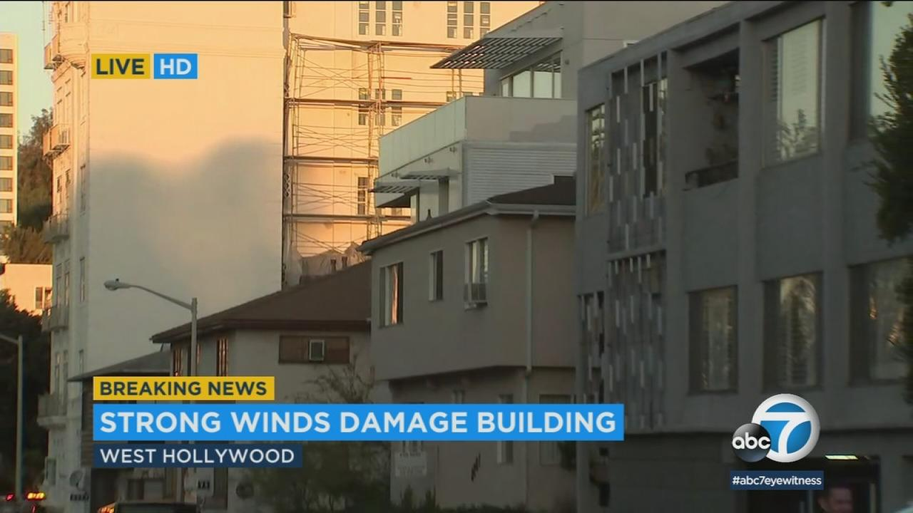 Some people in West Hollywood were evacuated Monday morning after strong winds blew heavy scaffolding through the roof of their apartments.
