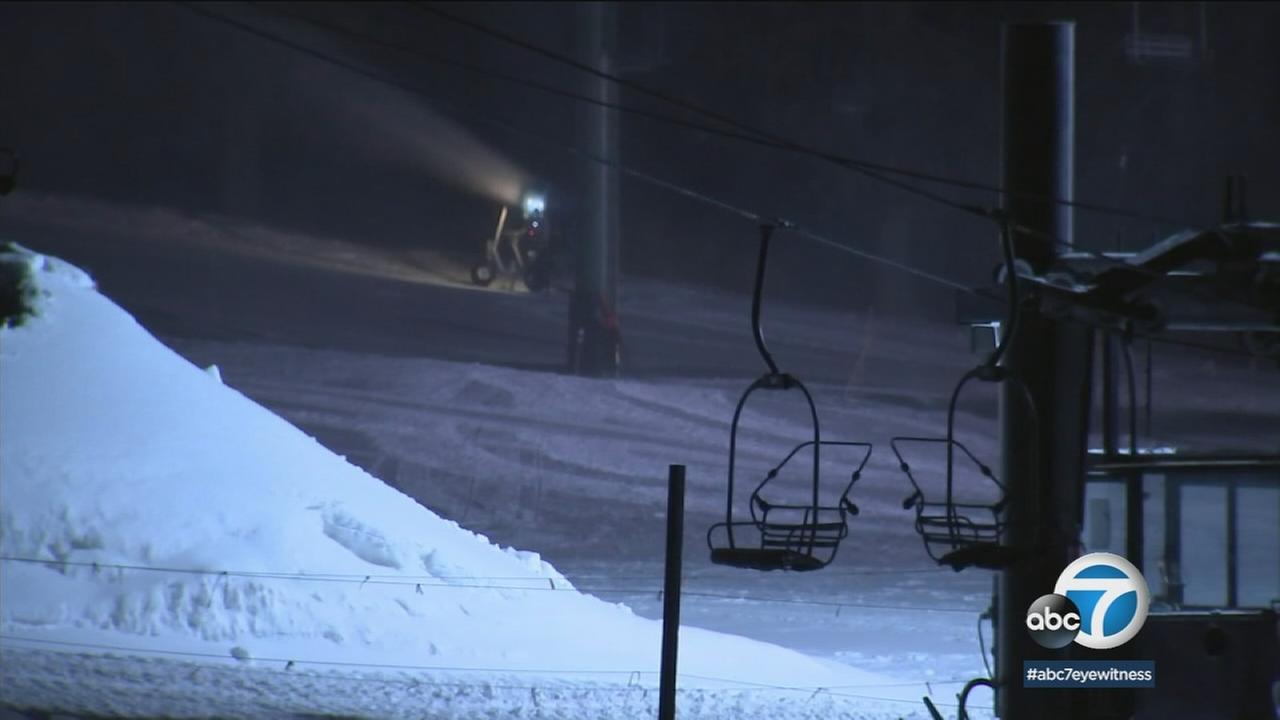 Snow at a ski lift is shown during a cold winter night in Southern California.