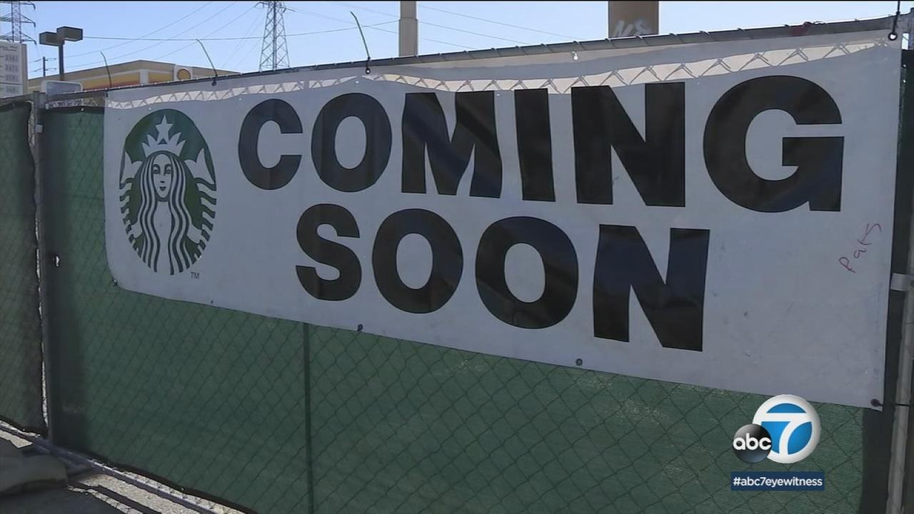 A sign for a Starbucks coming soon to Colton is shown. The gas station owner next door is disputing the property lines.
