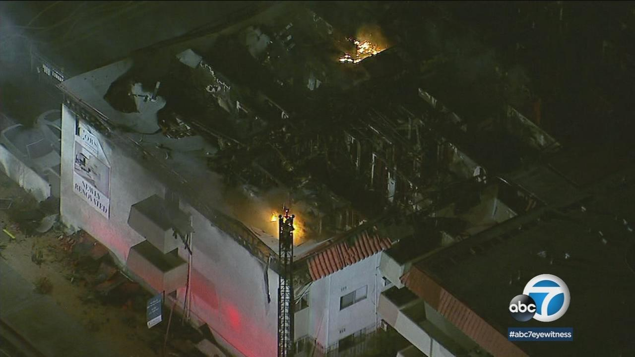 The remnants of an apartment building destroyed by a fire in Pico Rivera is shown in a photo.
