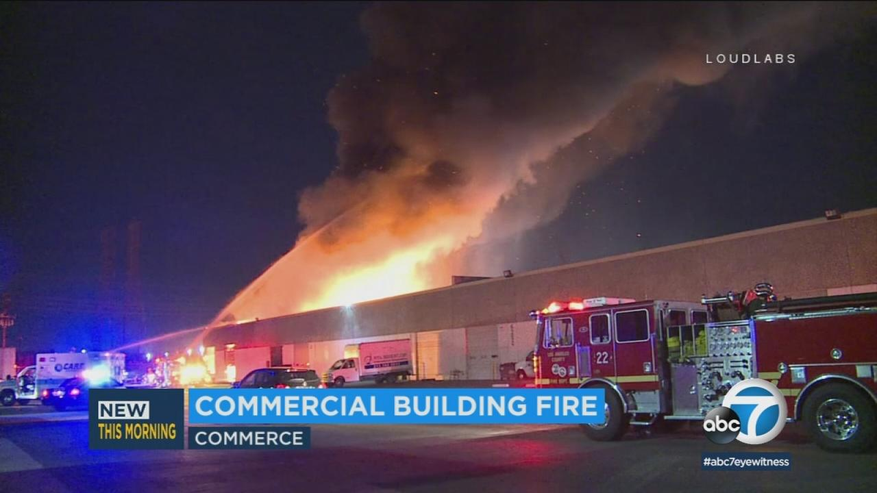 A dramatic blaze was extinguished by about 100 firefighters but not before it destroyed a commercial building in Commerce.