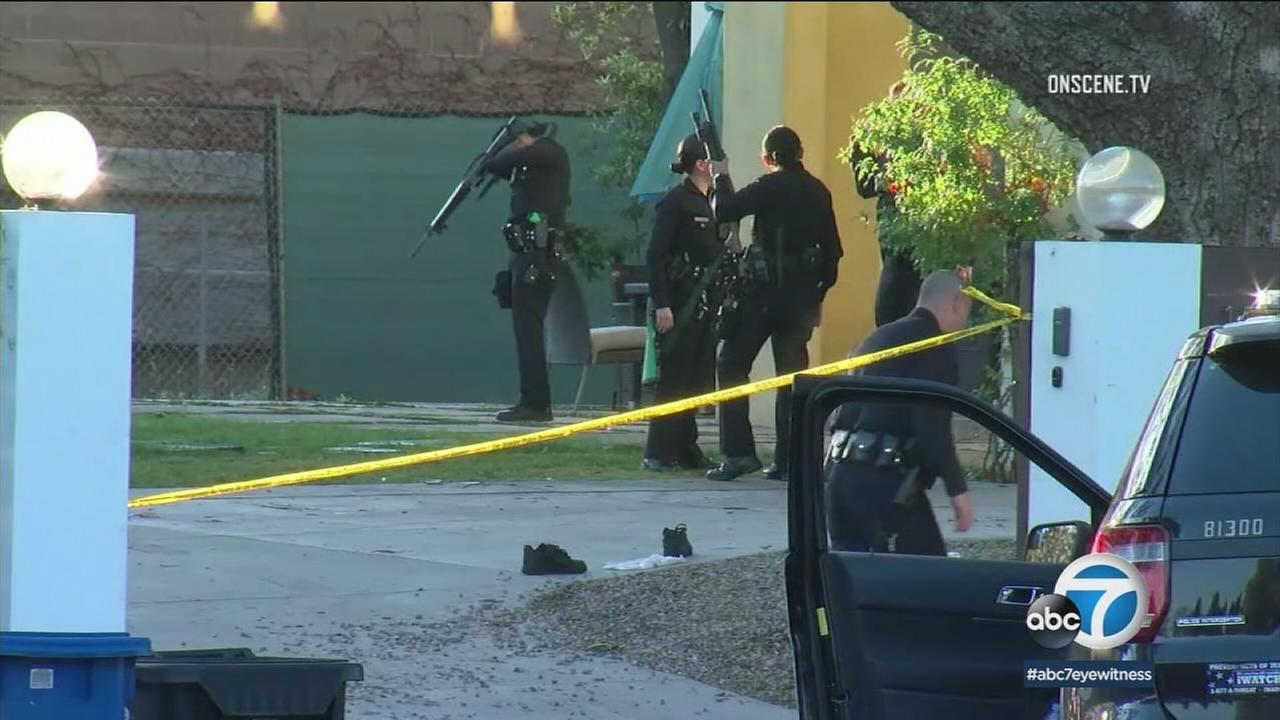 One man was shot in the arm and another person was grazed by gunfire during a home invasion robbery in Sherman Oaks.
