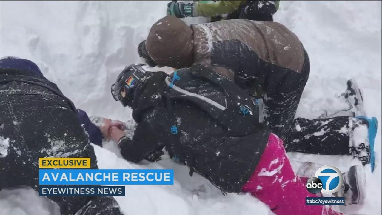 An avalanche crashed down on five people Friday at a Sierra Nevada ski resort, which fully buried at least one man who was rescued out.