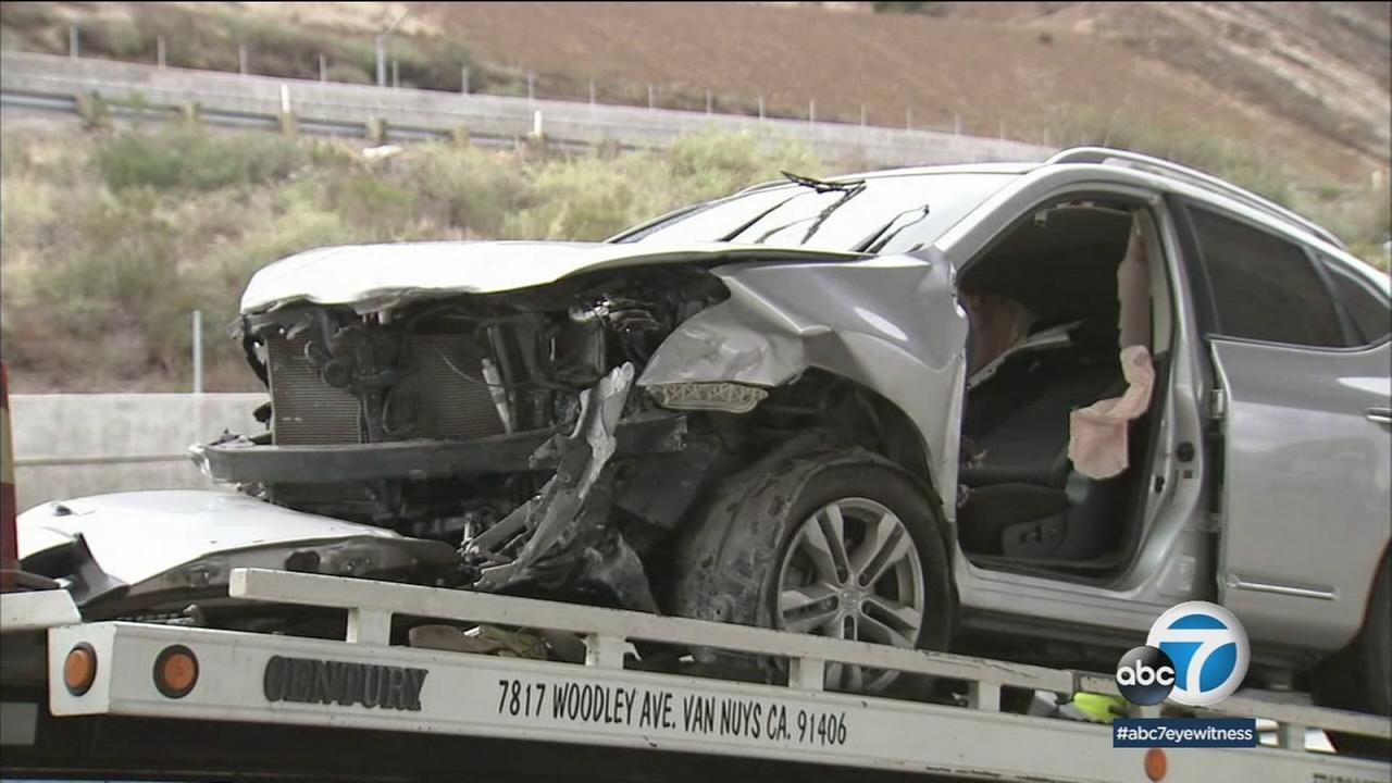 A mangled vehicle following a deadly crash in Sylmar that left one woman dead and three children injured on Saturday, March 3, 2018.
