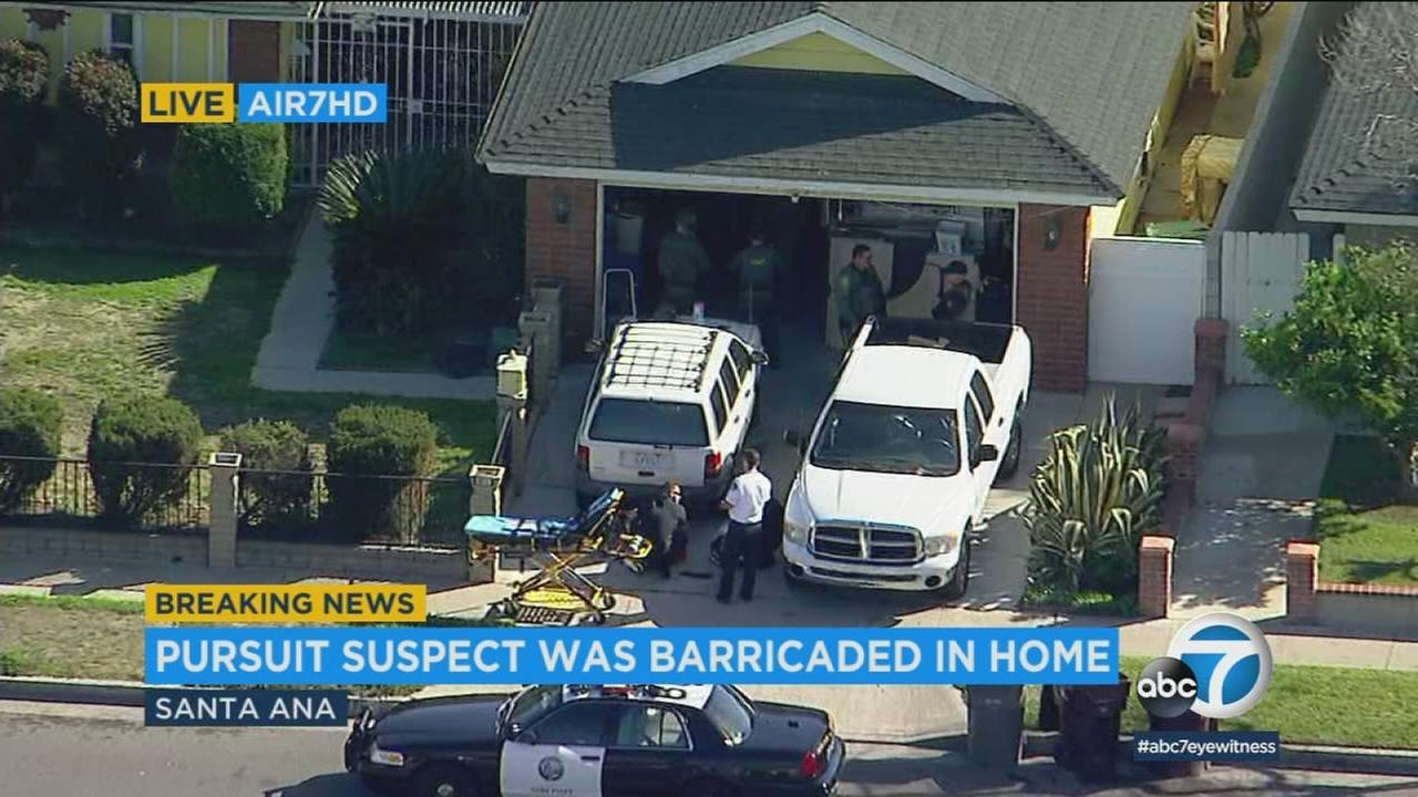 SWAT officers surrounded a home where a chase suspect barricaded himself in to evade capture in Santa Ana on Tuesday, March 6, 2018.