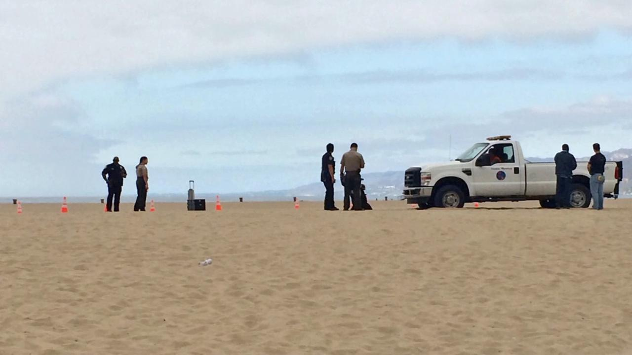 Authorities are seen on the beach in Santa Monica on Sunday, Sept. 21, 2014, near to where a man was apparently hit by a car.