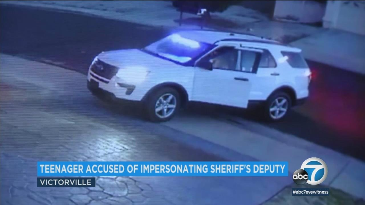 A 14-year-old boy accused of impersonating a sheriffs deputy allegedly used this SUV with flashing lights, captured by a surveillance camera, Monday, March 5, 2018.