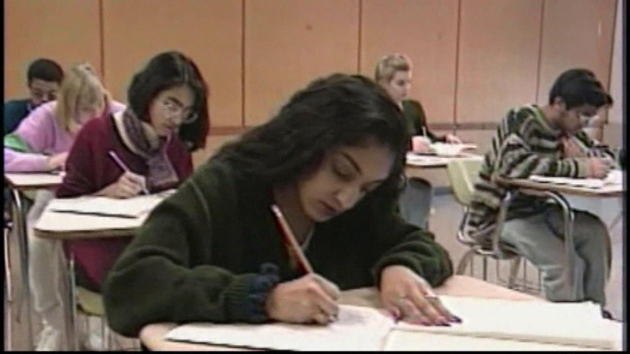 Students take an exam in this undated photo.