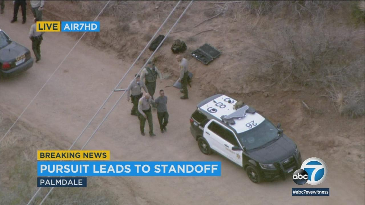 A chase suspect is taken into custody following a standoff in Palmdale on Friday, March 9, 2018.
