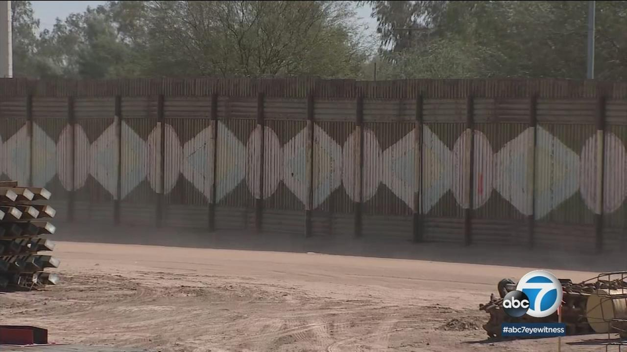 A border wall is shown at the Calexico border.