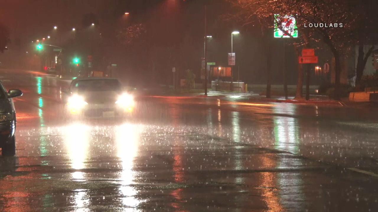 Heavy rain falls in the Burbank area as traffic flows on Thursday, March 15, 2018.