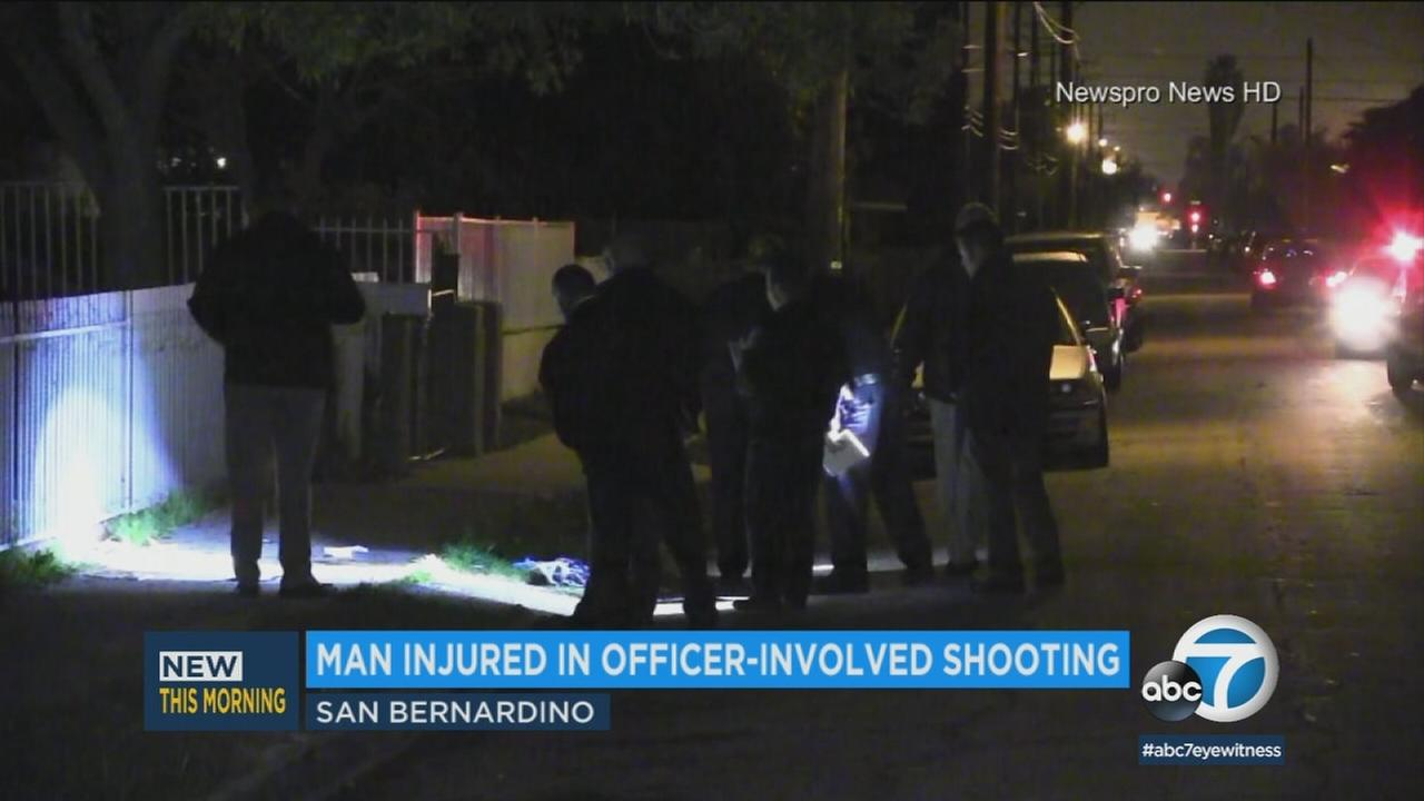 Officers investigate the scene of an officer-involved shooting in San Bernardino on Thursday, March 16, 2018.