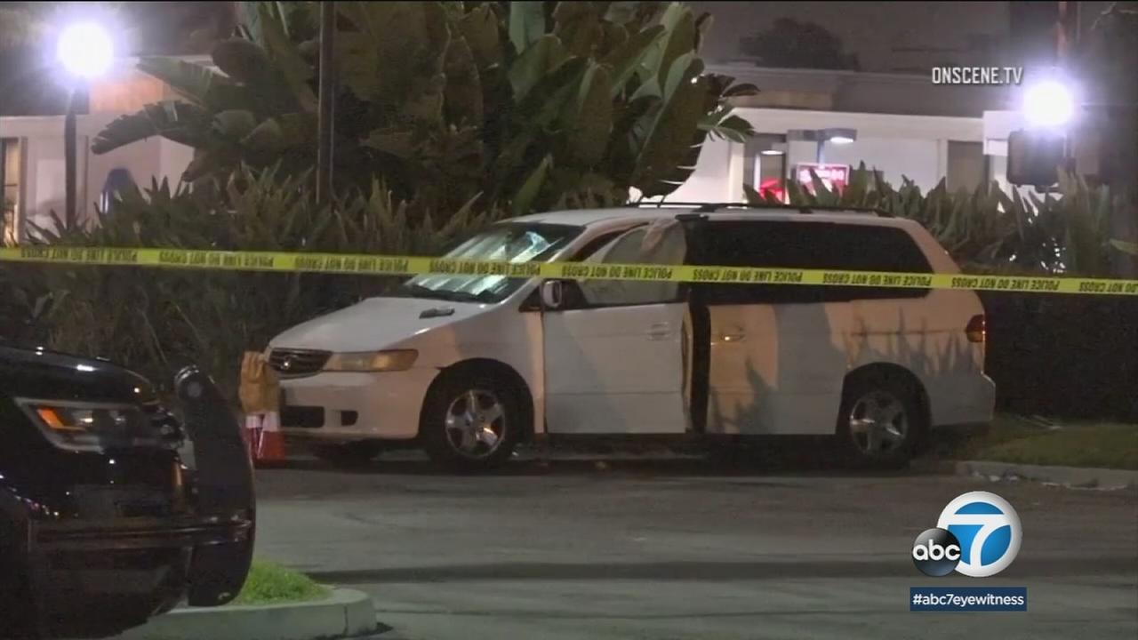 The bodies of four people -- two children, a man and woman -- were discovered in a minivan parked in a Garden Grove parking lot.